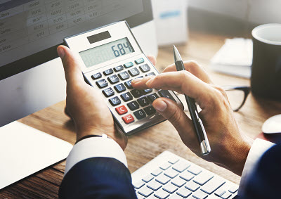 business person using calculator